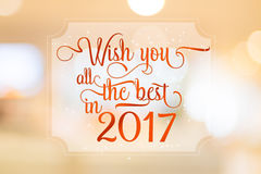 Wish you all the best in 2017 word on white frame at abstract bl. Urred bokeh light background, Holiday concept Vector Illustration