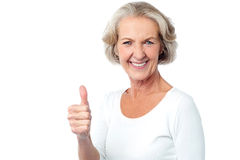 Wish you all the very best ahead !. Image of a senior lady showing success gesture Royalty Free Stock Photo