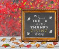 We wish you a happy thanks giving day design postcard banner. With autumn leaves Royalty Free Stock Images