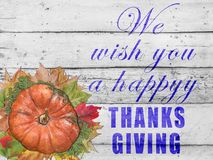 We wish you a happy thanks giving with pumpkin and autumn leaves. For thanksgiving day on white table stock photo