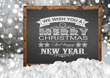We Wish You A Merry Christmas and Happy New Year on blackboard. Close Royalty Free Stock Photos