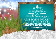We Wish You A Merry Christmas and Happy New Year on blank blue. Blackboard Royalty Free Stock Photography