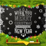 Wish you a merry christmas and happy new year. Wish you a merry christmas and a happy new year message, written on the school chalkboard Stock Images