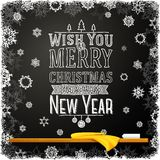 Wish you a merry christmas and happy new year. Wish you a merry christmas and a happy new year message, written on the school chalkboard. Like a greeting for Stock Photography
