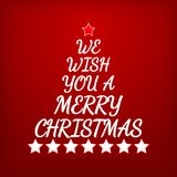 We Wish You a Merry Christmas. Letters and stars forming Christm Stock Photography