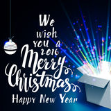 We wish you a Merry Christmas and Open gift with. Fireworks from light It can be used to design greeting cards Stock Photo