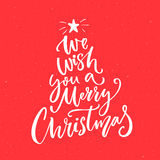 We wish you a Merry Christmas text. Calligraphy text for greeting cards. On red background Royalty Free Stock Photography