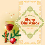 We wish you Merry Christmas text, Glass of wine and arabesques frame border. Stock Photo