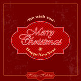 We wish you Merry Christmas text on grunge carmine background. Vintage Merry Christmas and New Year abstract background. We wish you Merry Christmas text on Royalty Free Stock Photos