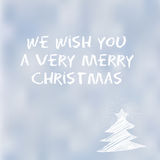 We Wish You a Very Merry Christmas typography message on a snow background Royalty Free Stock Image