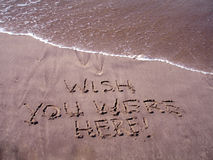 Wish you were here. Written in sand stock photo