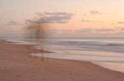 Wish you were here. Ghostly image of woman walking along a beach Royalty Free Stock Images