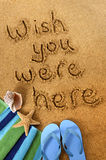 Wish you were here post card message written in sand Royalty Free Stock Photography