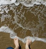 Wish You Were Here - Feet in Surf Royalty Free Stock Images