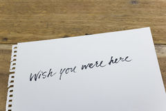 Wish you were here hand written on white paper Royalty Free Stock Photo