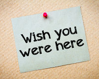 Wish You Were Here. Message. Recycled paper note pinned on cork board. Concept Image Stock Photos
