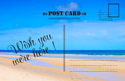 Wish You Were Here summer vacation postcard. With scenic ocean beach view royalty free stock images