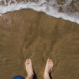 Wish You Were Here - Surf and Feet Royalty Free Stock Image