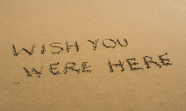 Wish You Were Here written in sand Royalty Free Stock Images