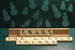 Wishes made from a word game: Enjoy the little things  Royalty Free Stock Photos