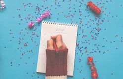 Wishes for the new year. Note book on blue background with spark. Les. Planning concept. Flat lay, top view. Closeup, copy space stock images