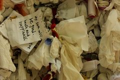 Wishes. Pieces of paper with written wishes tied to a wall at the Virgin Mary House near Kusadasi, Turkey Stock Photos