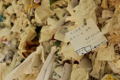 Wishes. Pieces of paper with written wishes tied to a wall at the Virgin Mary House near Kusadasi, Turkey Stock Image