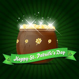 Wishes on St. Patricks Day with pot of gold. Shiny green background Royalty Free Stock Photos