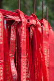 Wishes tape. Every one wrote down his wishes in red tape and tied to rail in Qingyun temple, Guangdong, China.Local people believe that can let dreams come true stock image