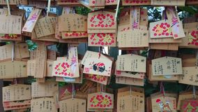 Wishes written on wooden plates in a Buddhist Temple in Japan - TOKYO / JAPAN - JUNE 12, 2018. Wishes written on wooden plates in a Buddhist Temple in Japan stock video