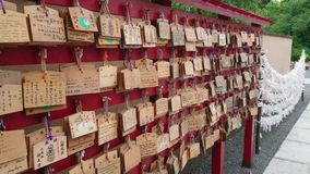 Wishes written on wooden plates in a Buddhist Temple in Japan. Travel photography stock video footage