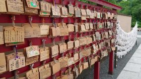Wishes written on wooden plates in a Buddhist Temple in Japan. Travel photography stock footage