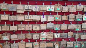 Wishes written on wooden plates in a Buddhist Temple in Japan. Travel photography stock video