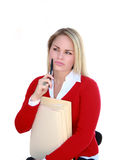 Wishful Office Worker. Pretty blonde office worker in contemplative pose, isolated on white Royalty Free Stock Photography