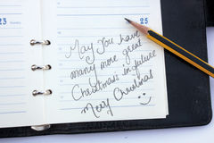 Wishing a Christmas. Christmas wishing message written on the diary Stock Images