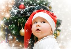 Wishing Girl In Red Santa Hat Stock Images