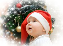 Wishing girl in red Santa hat Stock Photography