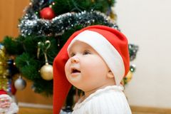 Wishing girl in red Santa hat Royalty Free Stock Photos