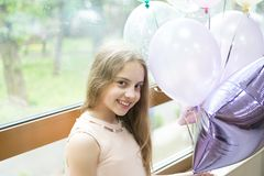 Wishing a happy holiday. Happy small child enjoying her birthday holiday. Adorable little girl celebrating holiday with. Party balloons. Joy and cheer, its a stock image