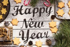Wishing a happy new year on a dark wooden background. Stock Images