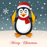 Wishing Merry Christmas with a Penguin Royalty Free Stock Photo