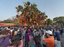 Wishing tree. HONG KONG , CHINA - FEB. 02 : Lam Tsuen wishing tree on Feb. 02 , 2014 in Hong Kong. Tourists wrote wishes on joss paper, tied to an orange, then stock photo