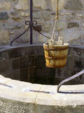Wishing well. A water well with an old bucket in Fort Louisburg, Nova Scotia stock image