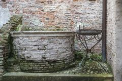 Wishing well against city wall in Cittadella, Italy stock photo