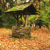 Wishing well in countryside royalty free stock photography