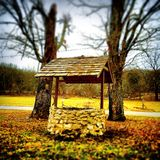Wishing well. Old brick wishing well on a farm royalty free stock images