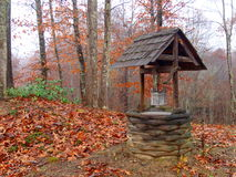 Wishing Well. A small wishing well surrounded by autumn leaves in the North Carolina mountains Royalty Free Stock Photos