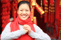 Wishing you a happy chinese new year. Oung asian woman wishing you a happy chinese new year
