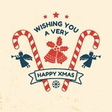 Wishing you very happy Xmas. Typography design. Vector illustration. Xmas retro badge with bells, ribbon, angels and Christmas candy. Concept for shirt or logo Royalty Free Illustration