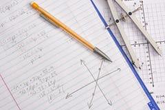 Wiskunde en Algebrathuiswerk Stock Afbeelding